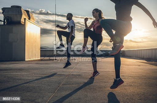 Three People Exercising Outdoors
