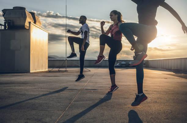 Three People Exercising Outdoors stock photo