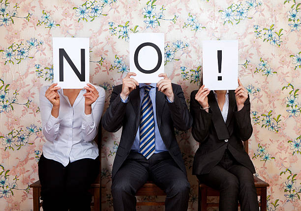 Three people holding the word NO! over their faces Judges holding up No sign single word no stock pictures, royalty-free photos & images