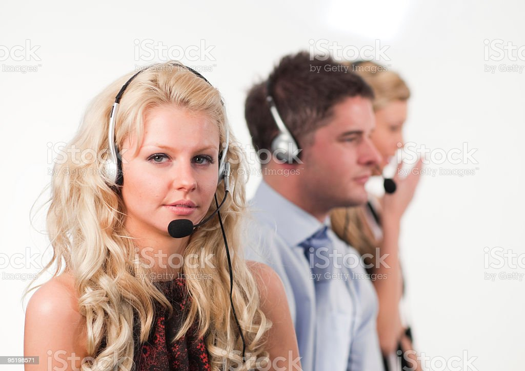 Three people in a call centre royalty-free stock photo