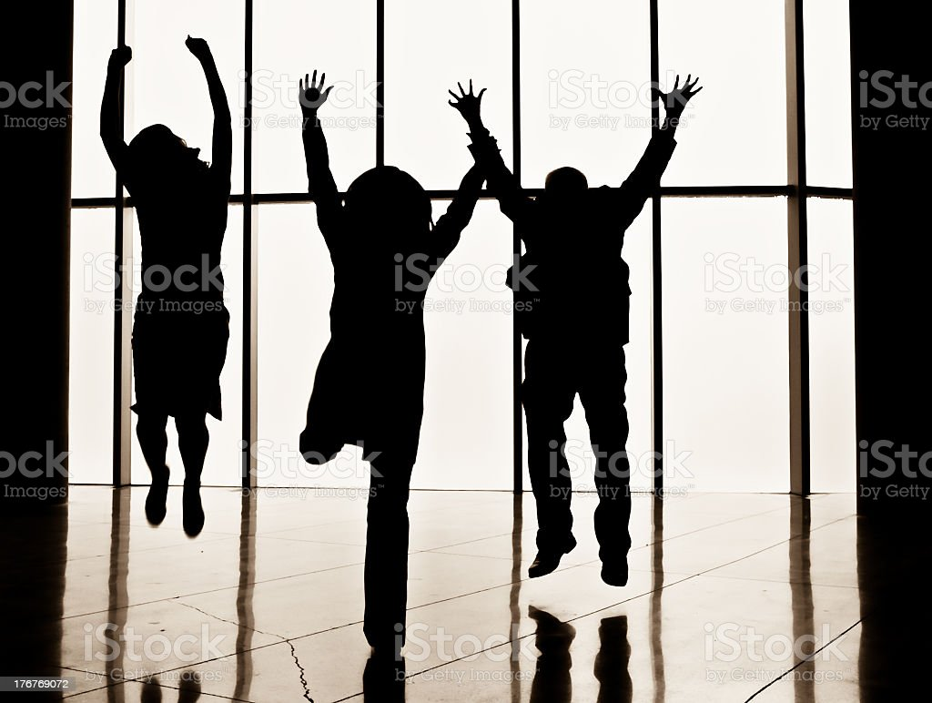 Three people jumping royalty-free stock photo