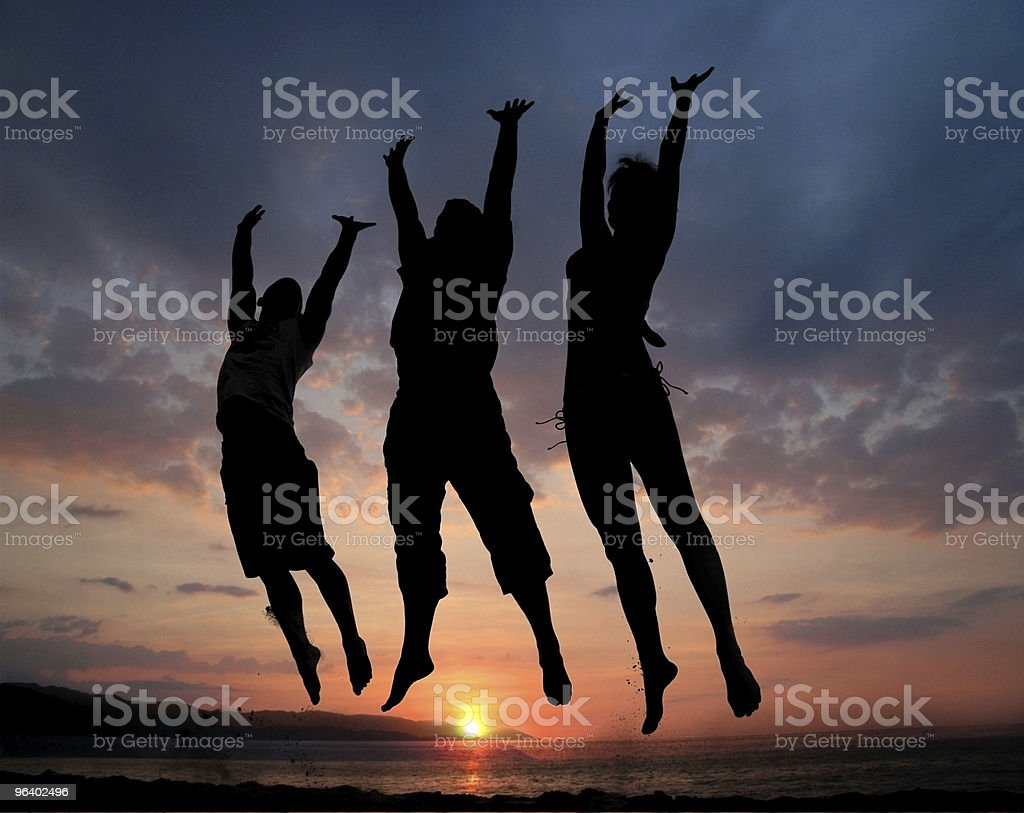 Three people jumping - Royalty-free Adult Stock Photo