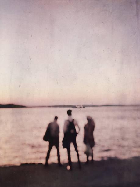 Three people on the seaside