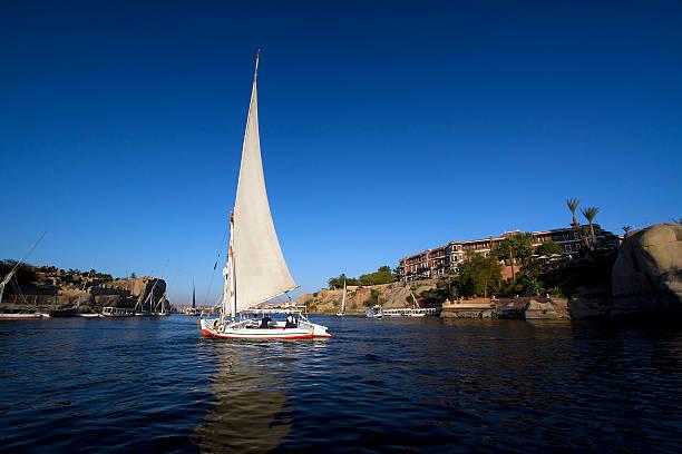 Three People Sailing in Aswan stock photo