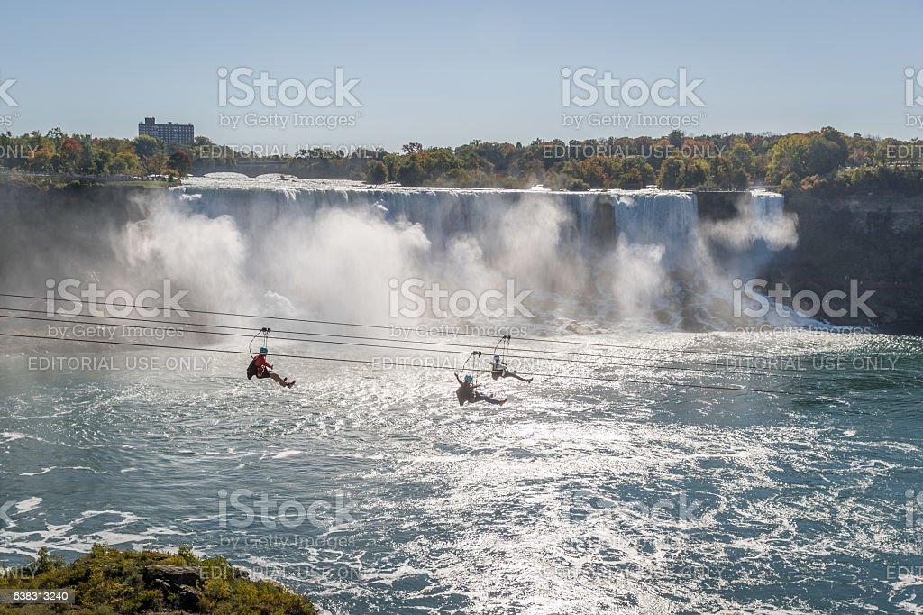 three people taking zipline ride niagara falls ontario canada 3人