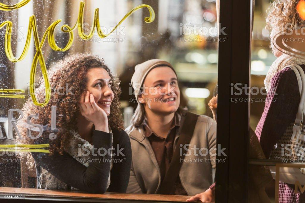 Three people talking in coffee shop stock photo