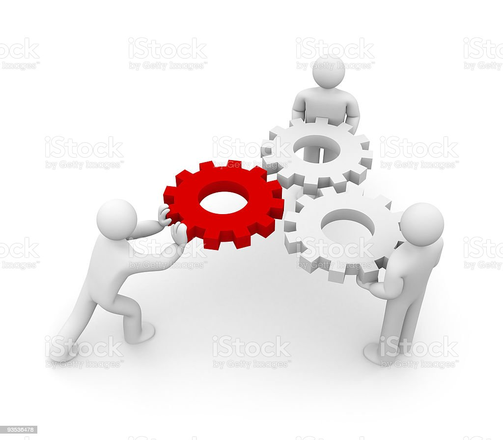 Three people working together to operate a mechanism royalty-free stock photo