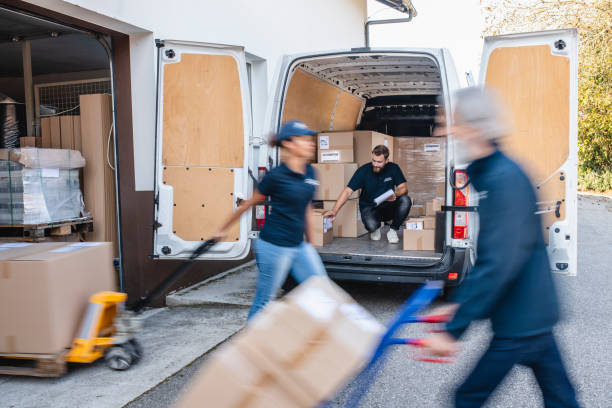 Three Person Independent Gig Delivery Team Managing Parcels stock photo