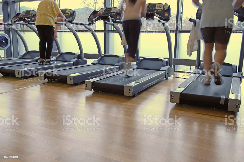 Three persons on a treadmill royalty-free stock photo