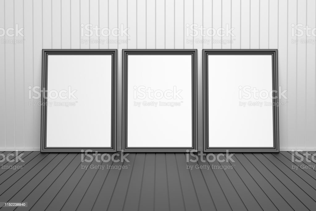 Three black picture frames in a room with. Picture frames for...