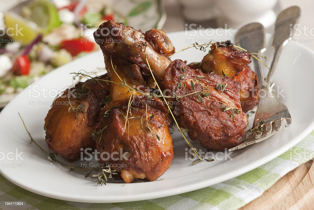 Three pieces of barbecue chicken on a plate  stock photo