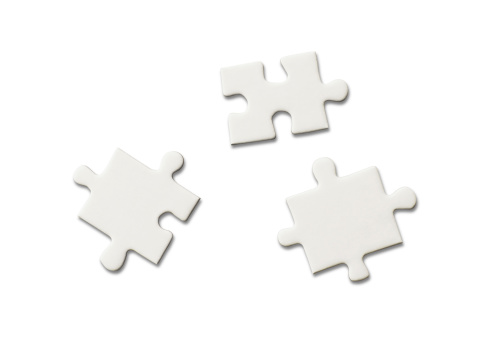 three pieces of blank jigsaw puzzle