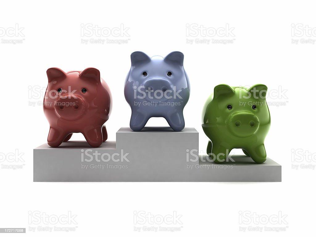 Three Piggy Banks on a Podium royalty-free stock photo