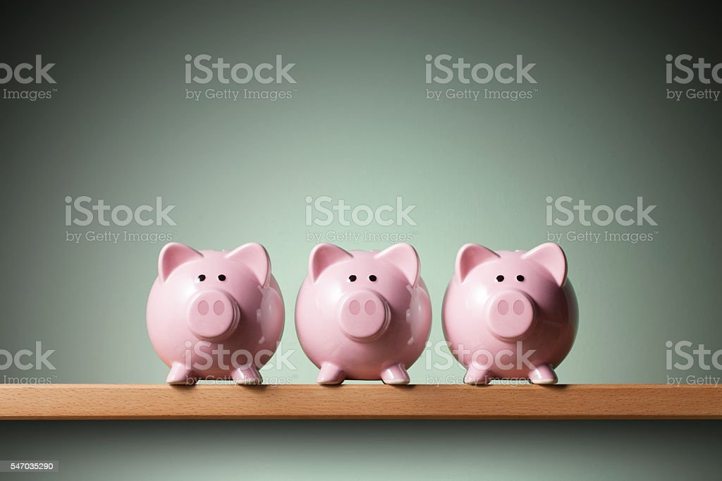 Three piggy banks stock photo