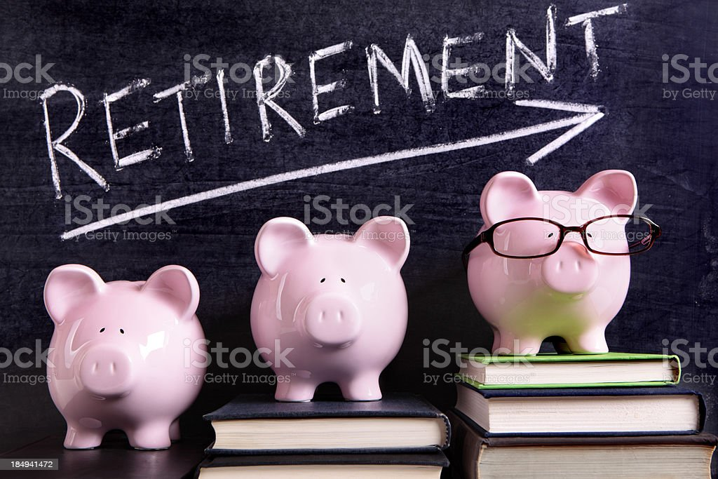 Three piggy banks with retirement savings message stock photo