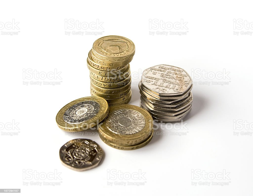 Three piles of silver and gold coins stock photo