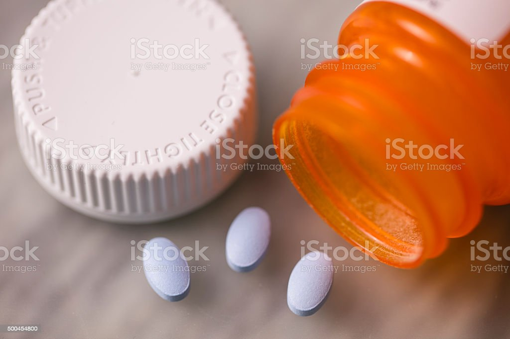 Three Pills From A Bottle stock photo