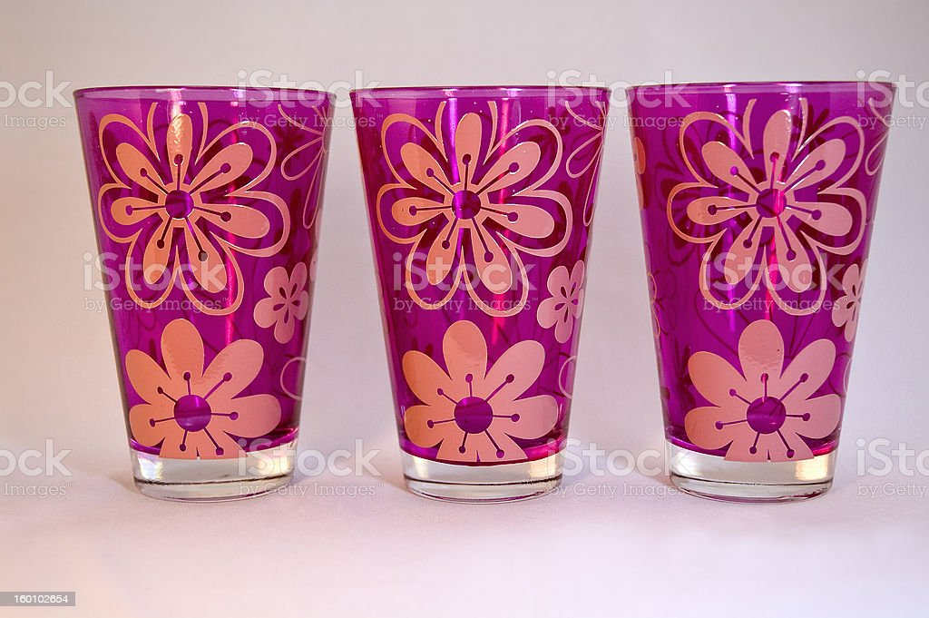 Three pink drinking glasses with flower design stock photo