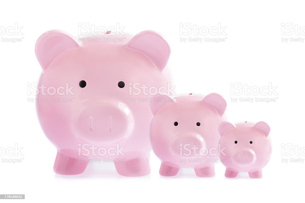 Three pink piggy banks stock photo