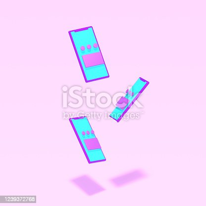 istock Three pink smartphones in a plastic toy style with apps in the screen levitate on a light pink background. 3D render. 1239372768