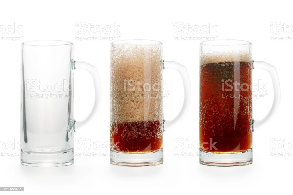 Three pints of dark beer. Empty, half full and full. stock photo