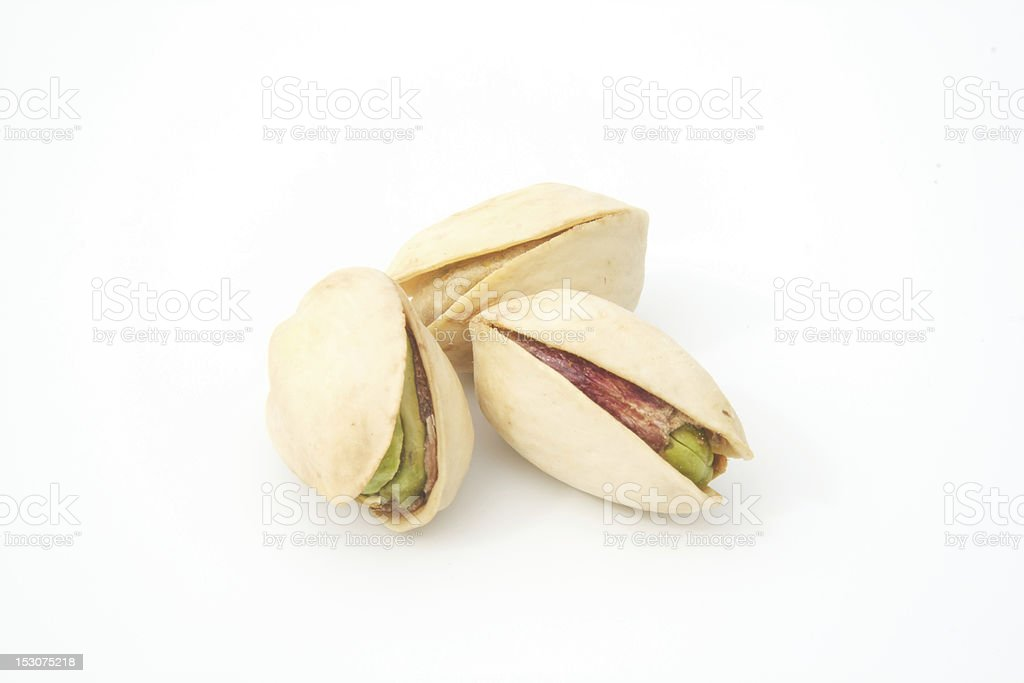 three pistachio nuts grouped royalty-free stock photo