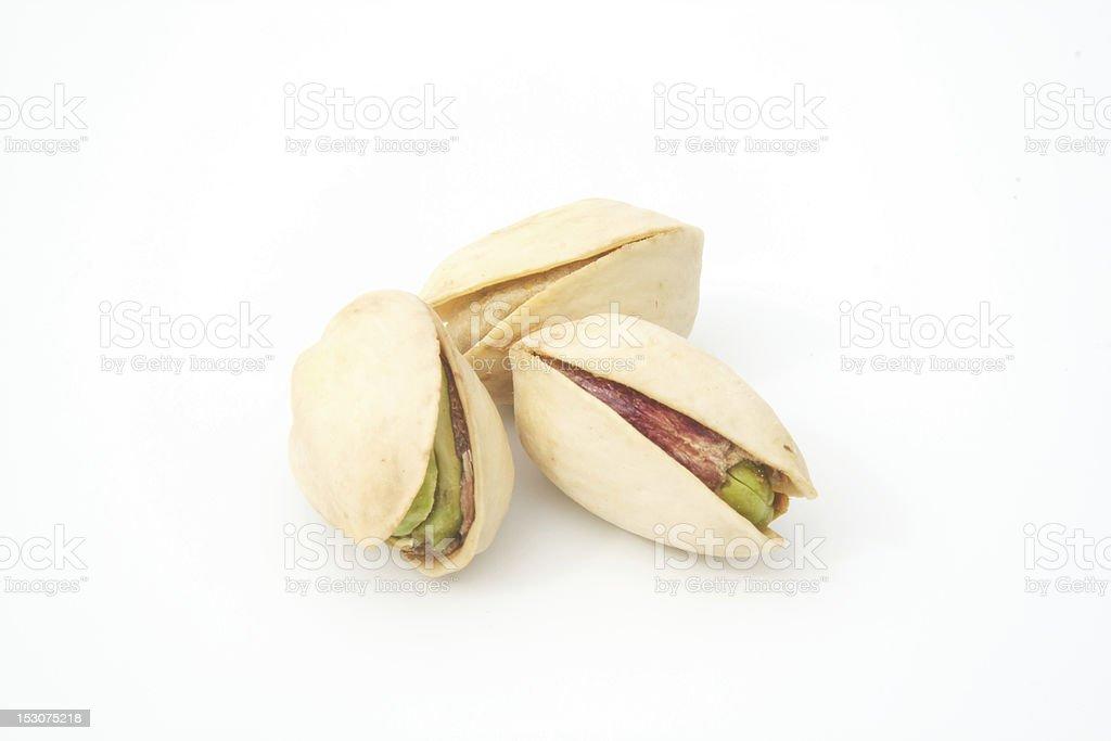 three pistachio nuts grouped stock photo