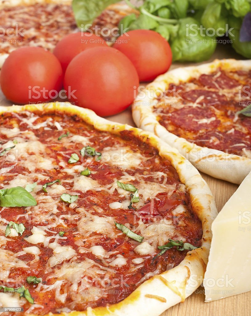 three pizzas and ingredients royalty free stockfoto