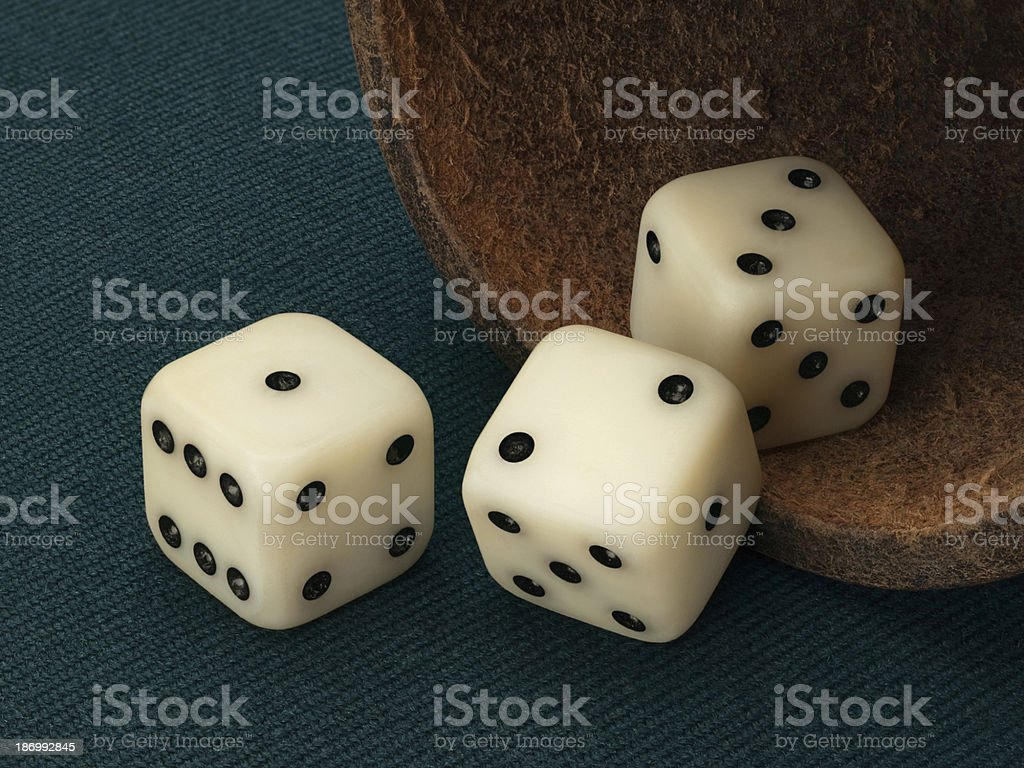 Three playing bones and leather cup stock photo