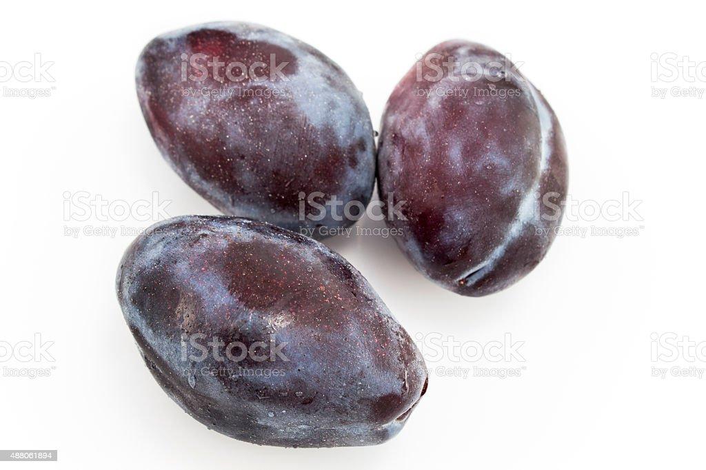Three plums stock photo