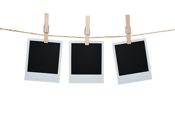 Three polaroid pictures hanging on a clothesline with pins picture id183574116?b=1&k=6&m=183574116&s=612x612&w=0&h=tkg2otg5apvnu d3tvc5wqznoabyyeph6ytm6cf3sfk=
