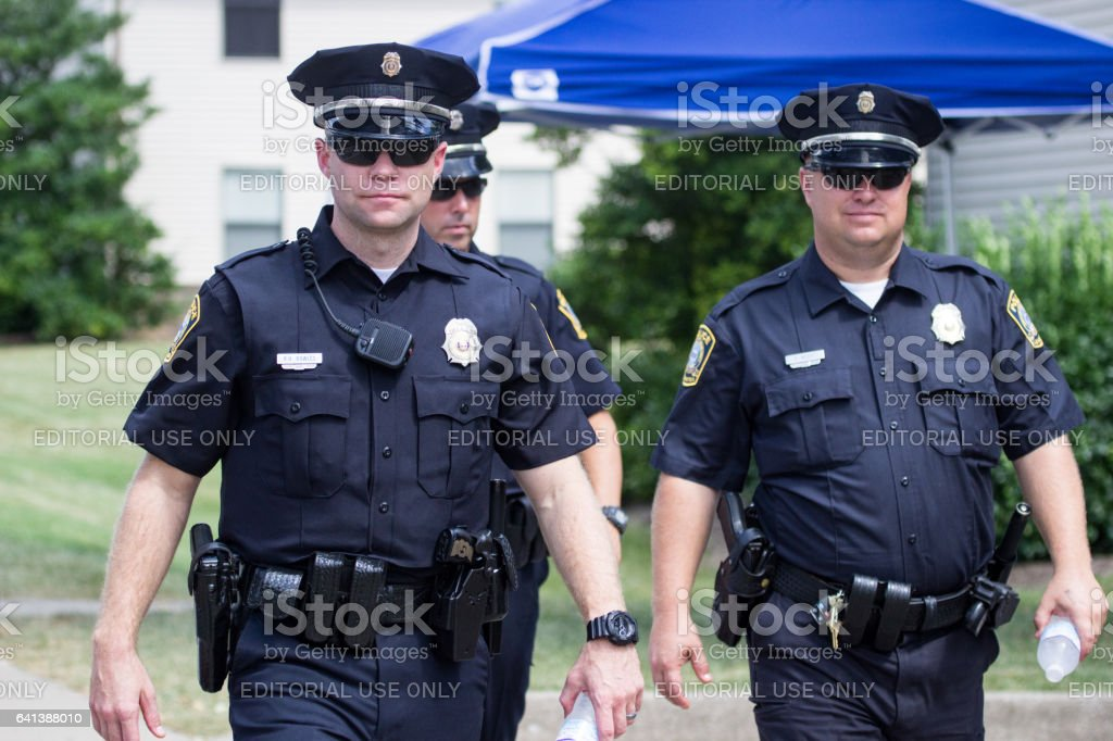 Three Police Officers Walking at the Roots and Heritage Festival stock photo
