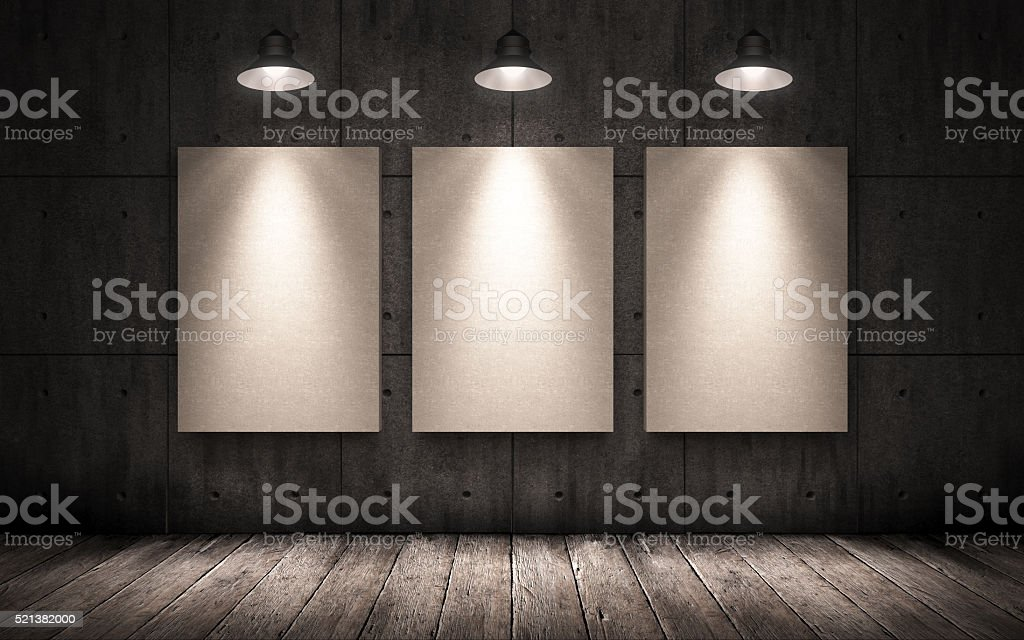 three posters hanging in the industrial interior. mock up stock photo