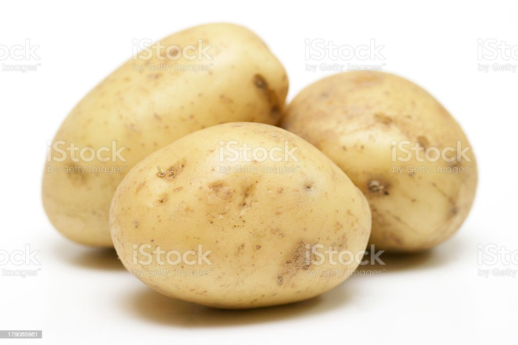 Three potatoes on a white background stock photo