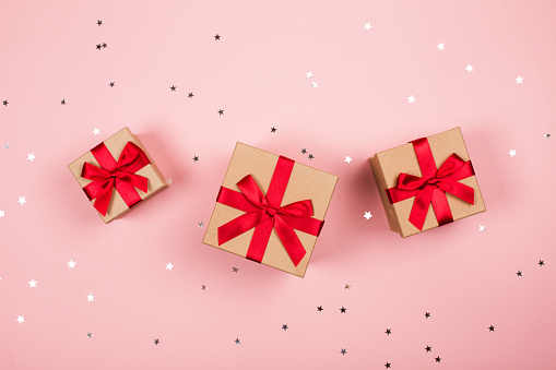 Three Presents With Red Bow On Pink Stock Photo - Download Image Now