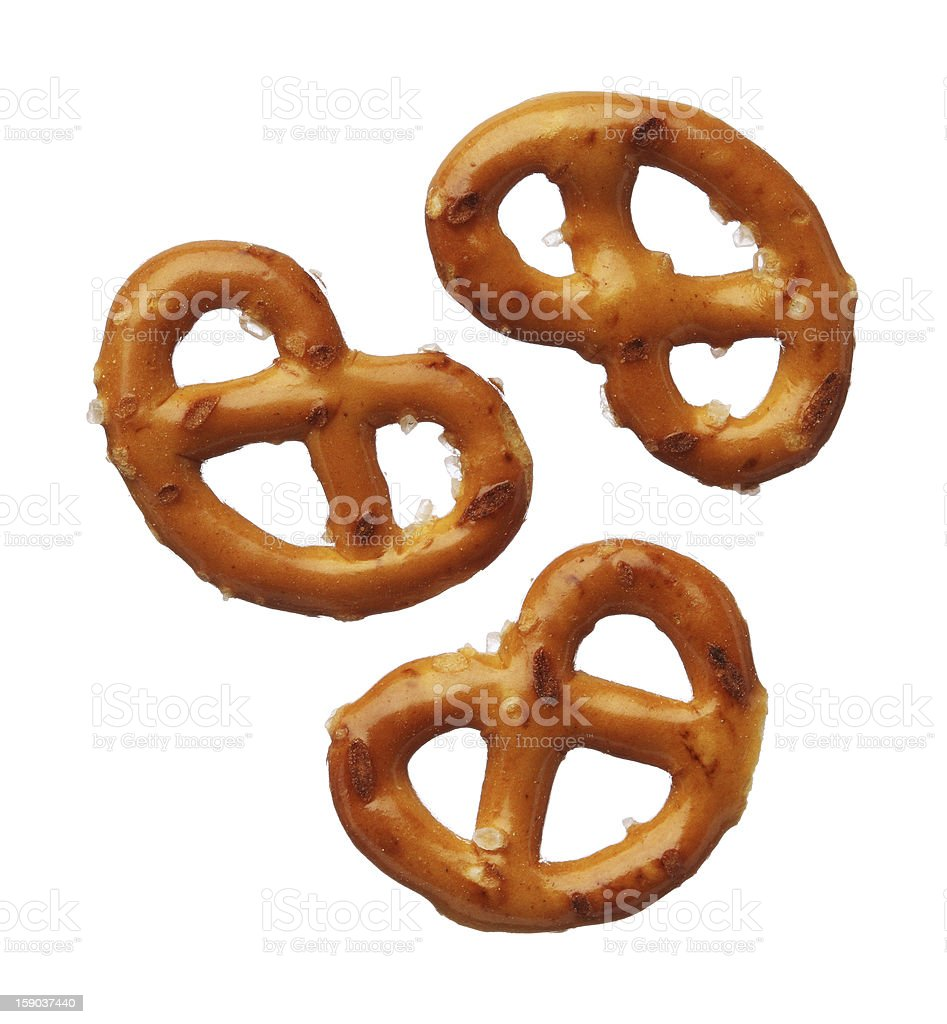 Three pretzels isolated on white background, close-up stock photo