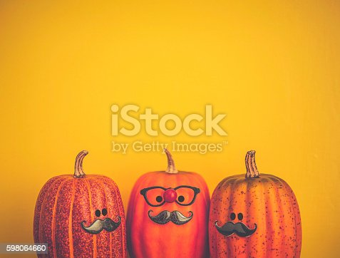 istock Three pumpkin characters wearing mustaches for Halloween 598064660