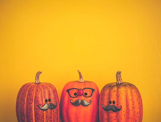Three pumpkin characters wearing mustaches for Halloween - Photo