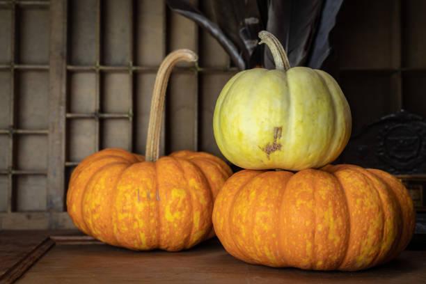 three pumpkins on wooden table fall decoration - pumpkin pie стоковые фото и изображения