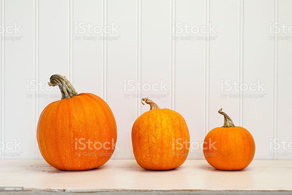 Three pumpkins stock photo