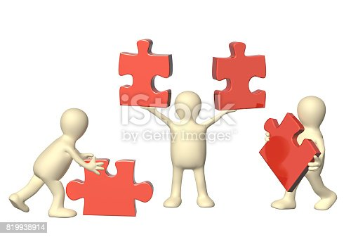 istock Three puppets with puzzles 819938914