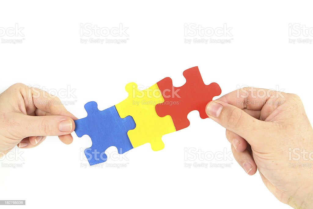 Three Puzzle Pieces in Hands royalty-free stock photo