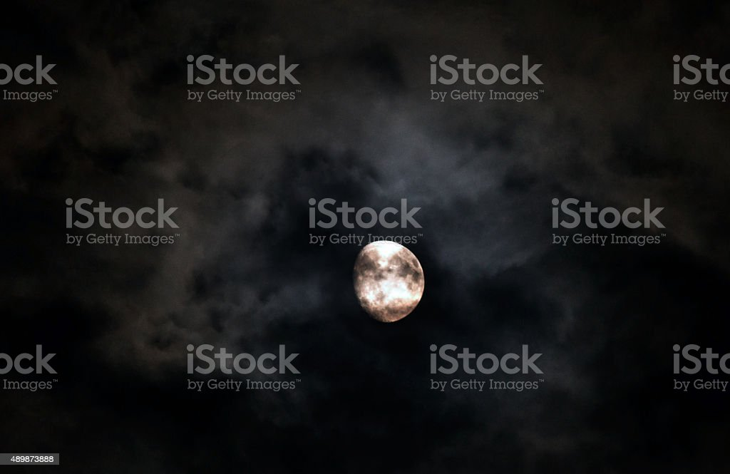 three quarter 3/4 moon with clouds stock photo