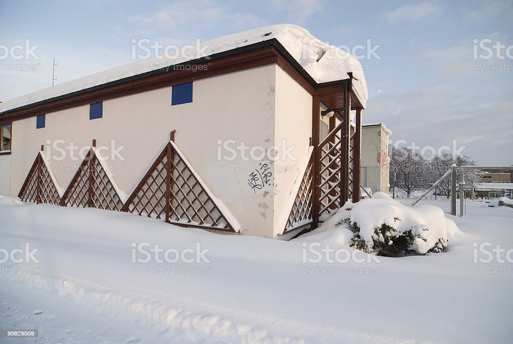 Three Quarter Building with Snow stock photo