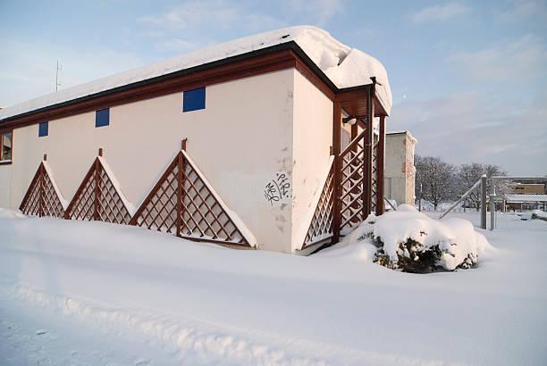 Three Quarter Building with Snow stock photo