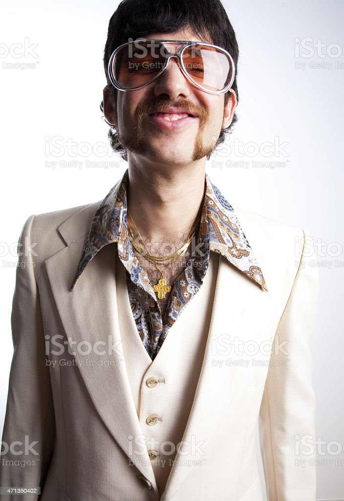 three quarter view of man in white leisure suit stock photo