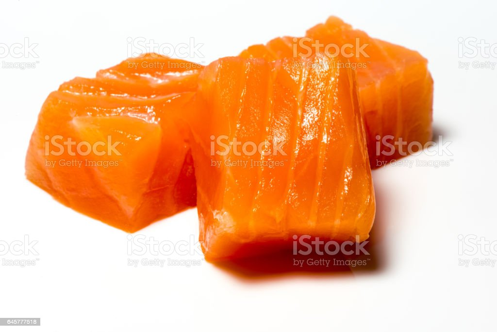 Three Raw Salmon sushi cubes stock photo