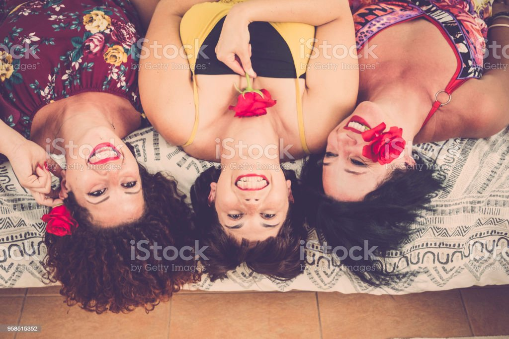 three real girlfriends at home on the bed stock photo