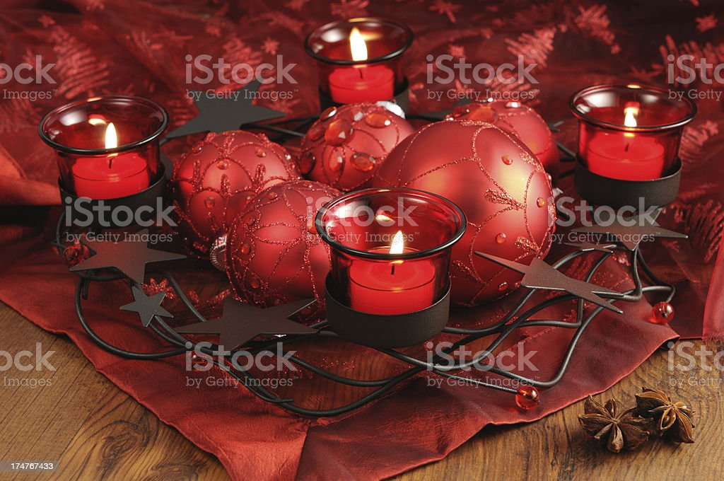 three red Advent tealight candle burning on table royalty-free stock photo