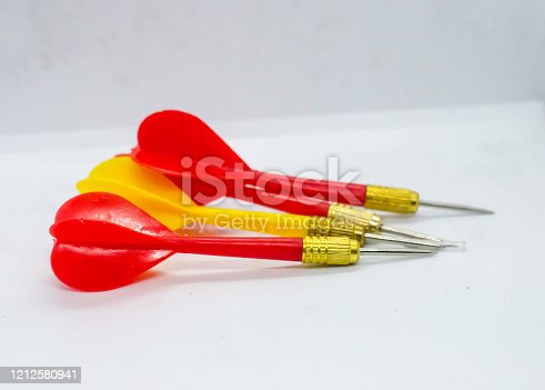919544754 istock photo Three Red and one Yellow darts in the same direction. Concept the odd one to hit the target. 1212580941